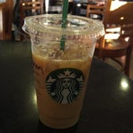 Photo taken at Starbucks by Andre A. on 5/22/2015