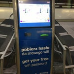 Free WiFi (30 min) with any boarding card. Just get your login and password from vending machines close to gates.