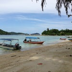 Photo taken at Watercolours Resort & Dive Centre by Wong K. on 10/13/2013