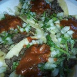 Photo taken at King Taco Restaurant by Erica I. on 3/14/2012