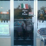 Photo taken at Scalini's Pizza & Pasta by Bartley W. on 7/6/2012