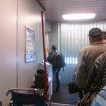 Photo taken at Gate D8 by Manny S. on 12/7/2011
