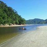 Photo taken at Praia Dura by Andréa F. on 3/18/2012