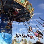 Photo taken at Silly Symphony Swings by Michelle V. on 3/12/2012
