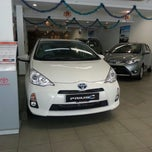Photo taken at Toyota Showroom by Lilian Wong on 10/28/2013