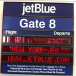 Photo taken at Gate 8 by Shelley K. on 1/27/2013