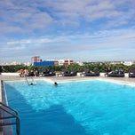 Photo taken at Hilton Hotel Rooftop Pool by Carlos Edmur L. on 1/3/2014