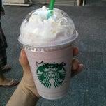 Photo taken at Starbucks Coffee by Melina M. on 6/23/2013