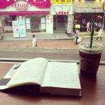 Photo taken at Starbucks by Minji on 8/7/2013