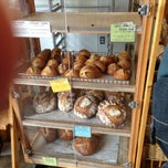 Photo taken at Arizmendi Bakery Panaderia & Pizzeria by Tim O. on 2/18/2013