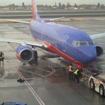 Photo taken at Gate 26 by Volkan O. on 12/4/2014