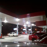 Photo taken at Caltex by Austin M. on 4/4/2014