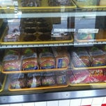 Photo taken at Golden Krust Caribbean Bakery and Grill by Ken W. on 7/8/2013