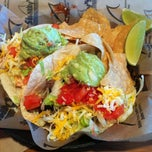 Photo taken at Sharky's Woodfired Mexican Grill by Vanessa C. on 1/5/2013