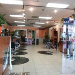 Photo taken at Elite Hair Salon by Daman B. on 7/17/2013
