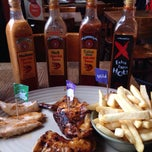 Photo taken at Nando's by Daniella d. on 11/9/2014