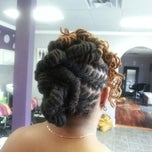 Photo taken at Coils Hair Lounge by Nicole R. on 4/29/2013