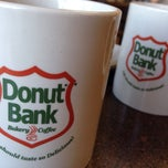 Photo taken at Donut Bank Bakery & Coffee Shop by Debbie V. on 4/26/2014