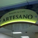 Photo taken at Artesano Bakery and Cafe by Mike J. on 10/5/2012