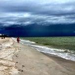 Photo taken at Bonita Beach by E M. on 7/6/2013