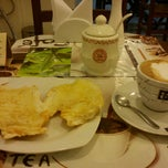 Photo taken at Café Petit by Sae K. on 10/10/2012