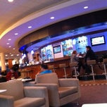 Photo taken at Delta Sky Club by Dipesh P. on 12/24/2012