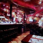 Photo taken at Happy Bar and Grill by Oana C. on 2/28/2013