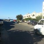Photo taken at Marina Velca Beach by Edward Frank S. on 8/29/2014