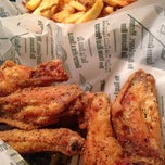 Photo taken at Wingstop by Derick T. on 9/4/2014
