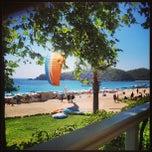 Photo taken at Buzz Beach Bar by BeLiz M. on 8/7/2013