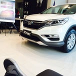 Photo taken at Honda Cars Global City by Mark S. on 1/8/2015