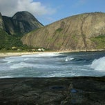 Photo taken at Praia de Itacoatiara by Gilson R. on 3/16/2013