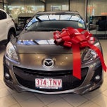 Photo taken at Eagers Mazda by Erik V. on 12/19/2013