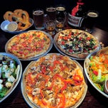 Photo taken at Pub Dog Pizza & Drafthouse by The Baltimore Sun on 12/7/2012