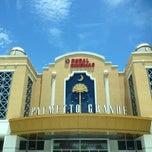 Photo taken at Regal Cinemas Palmetto Grande 16 by Sarah G. on 6/23/2013