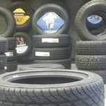 Photo taken at Mr. Tire by Douglas T. on 3/18/2013