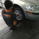 Photo taken at QS tyres & auto services by Hazman Y. on 11/22/2014
