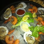Photo taken at Scuttlebutt's Seafood Bar & Grill by Carlos S. on 3/4/2013