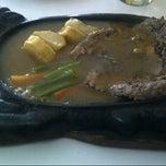 Photo taken at Waroeng Steak & Shake by Nova U. on 1/19/2013