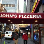 Photo taken at John's Pizzeria by Kelley A. on 5/6/2013