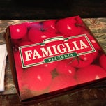 Photo taken at Famous Famiglia Pizza by Lane R. on 12/10/2012