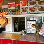 Photo taken at Cha Cha Chicken by Ian K. on 2/7/2013