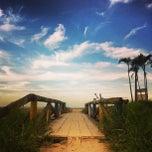 Photo taken at Praia de Itapoá by Djessica D. on 7/14/2013