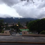 Photo taken at Glorieta de Jacarándas by Inti Ayora on 11/19/2013