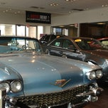 Photo taken at Jeff Schmitt Cadillac by Tina W. on 3/13/2013