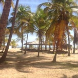 Photo taken at Playa de Boca de Uchire by Aracelis M. on 8/24/2014