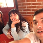 Photo taken at Los Pimientos De Auco Restaurant by Carlos C. on 10/5/2014