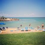 Photo taken at Pernera Beach by Яна Р. on 5/18/2013