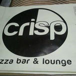Photo taken at CRISP Pizza Bar & Lounge by Chris S. on 9/5/2011