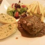Photo taken at Taste Restaurant by Masami W. on 6/21/2014